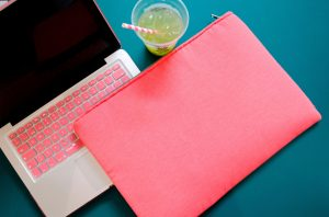 pink laptop on a desk